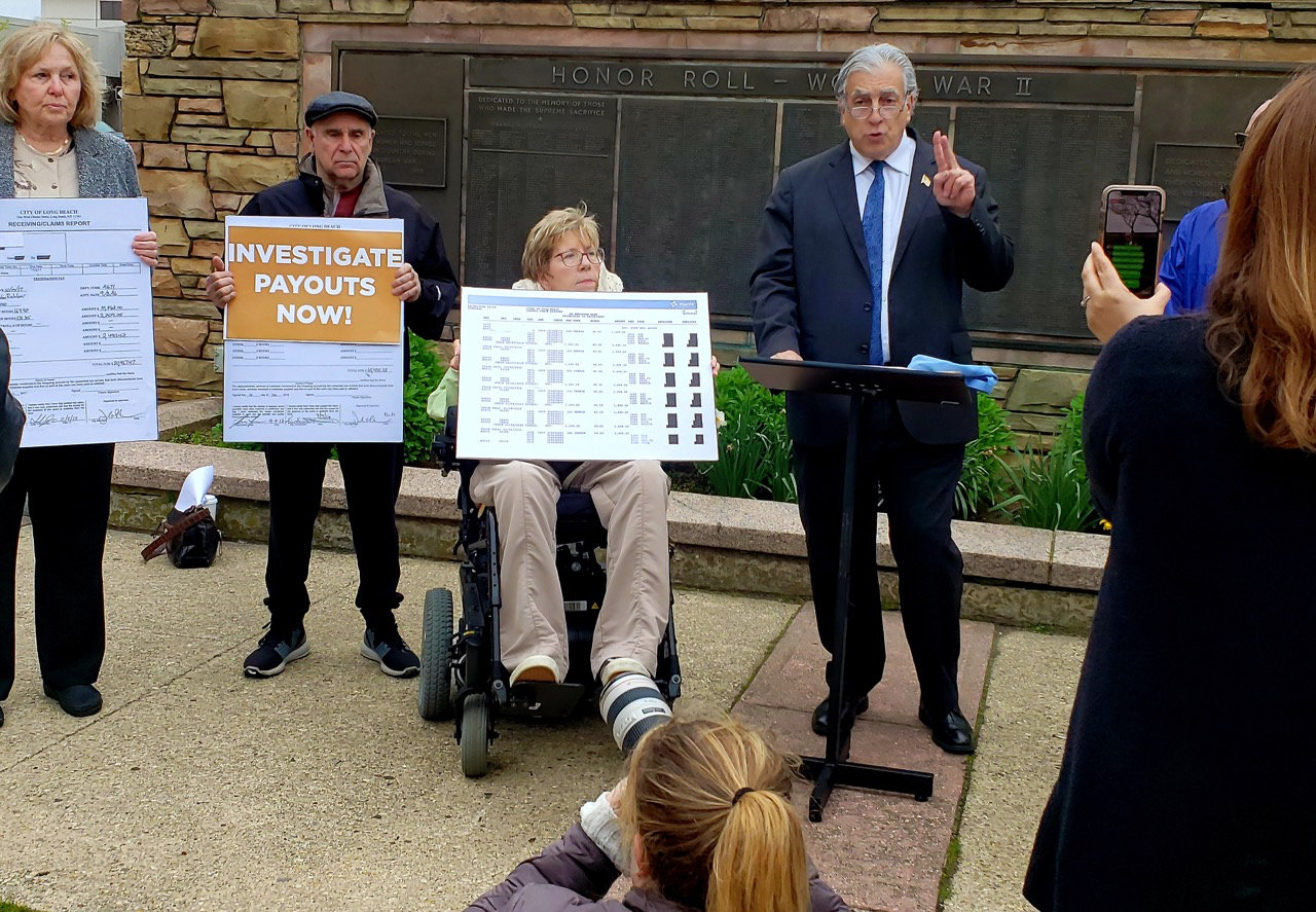 Frank McQuade, right, a Republican running against Nassau County District Attorney Madeline Singas, held a rally in front of City Hall on Wednesday before the City Council approved a $400,000 bond measure to cover separation payments in the current fiscal year. McQuade criticized the borrowing measure and called on Singas to investigate separation payouts to city employees in the 2017-18 fiscal year that are currently being audited by State Comptroller Tom DiNapoli's office. Singas said that the investigation is already underway.
