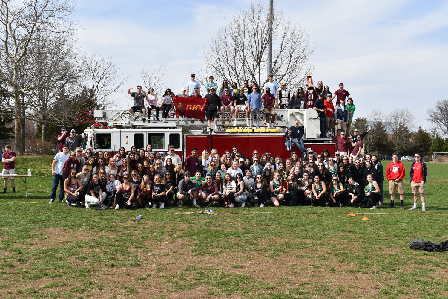 Members of Pi Kappa Alpha, the East Williston Fire Department and participating sororities posed for a group photo.