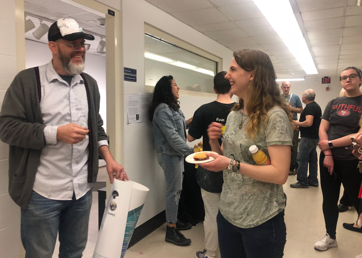 Hofstra junior Amanda Lastella chatted with Lee at his reception, celebrating all the hard work he has done in the university's fine art department.
