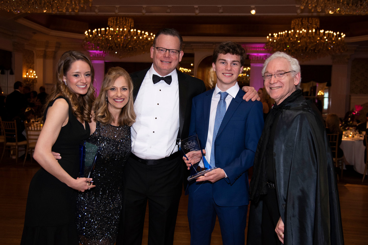 Brooke Williams, left, and her brother, Jack, second from right, were honored at the Cancer Center for Kids at New York University Winthrop Hospital's Black and White Ball. They were joined by their parents, Donna-Marie Korth-Williams and Ken Williams, and Dr. Mark Weinblatt, far right, chief of the Pediatric Hematology/Oncology at NYU Winthrop Hospital and the director of the Cancer Center for Kids.