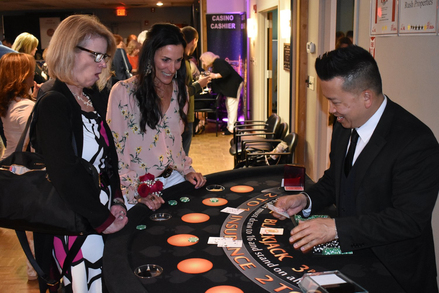 Regina Phillips, left, and Christine Grillo played blackjack at Monte Carlo Night on May 3.