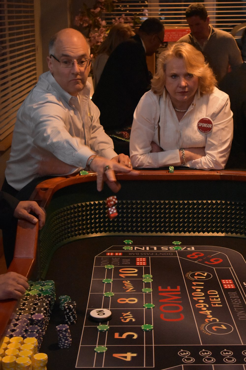 Dan Navarino, left, tested his luck at a craps table as Lisa Spatz looked on.