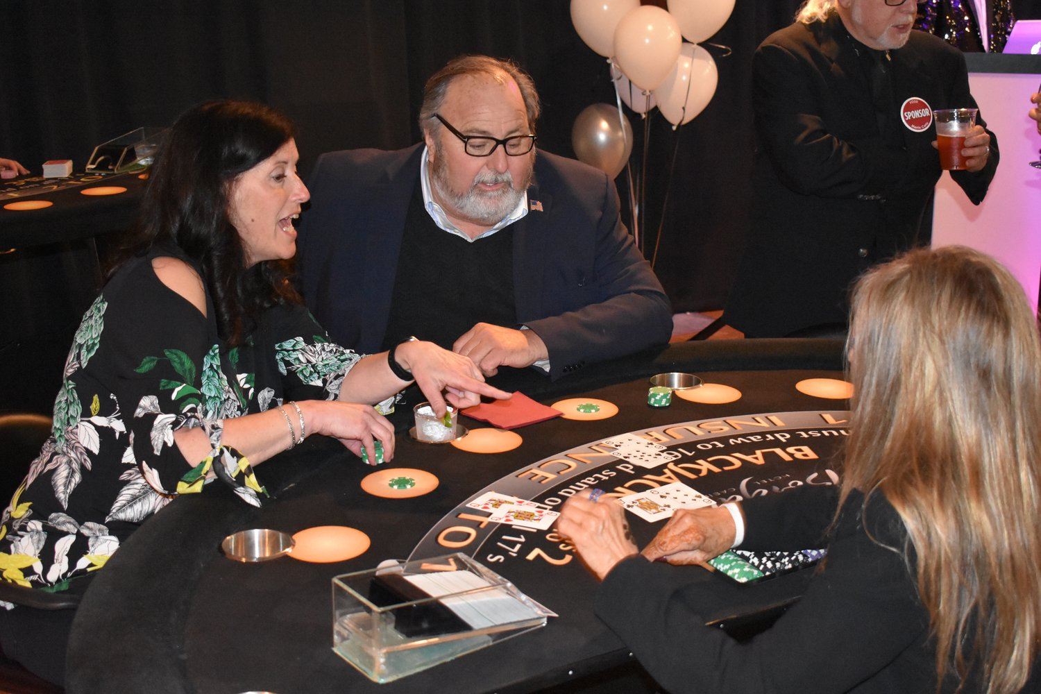 Rockville Centre Deputy Mayor Kathy Baxley advised Mayor Francis X. Murray at the blackjack table.