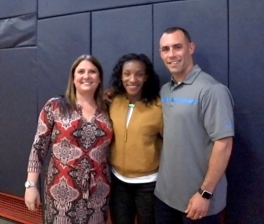 Crystal Dunn visited her former school counselor, Joanna Zweben, and teacher Brian Manolakes at South Side High School on May 2.