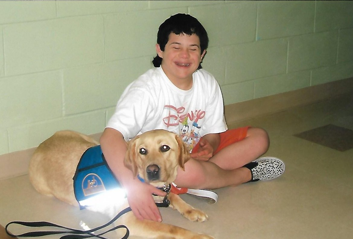 Milano was inspired to train a service dog from Canine Companions for Independence for people in need when she saw the profound impact a yellow lab named Octavia had on her younger brother, John, when they were younger.