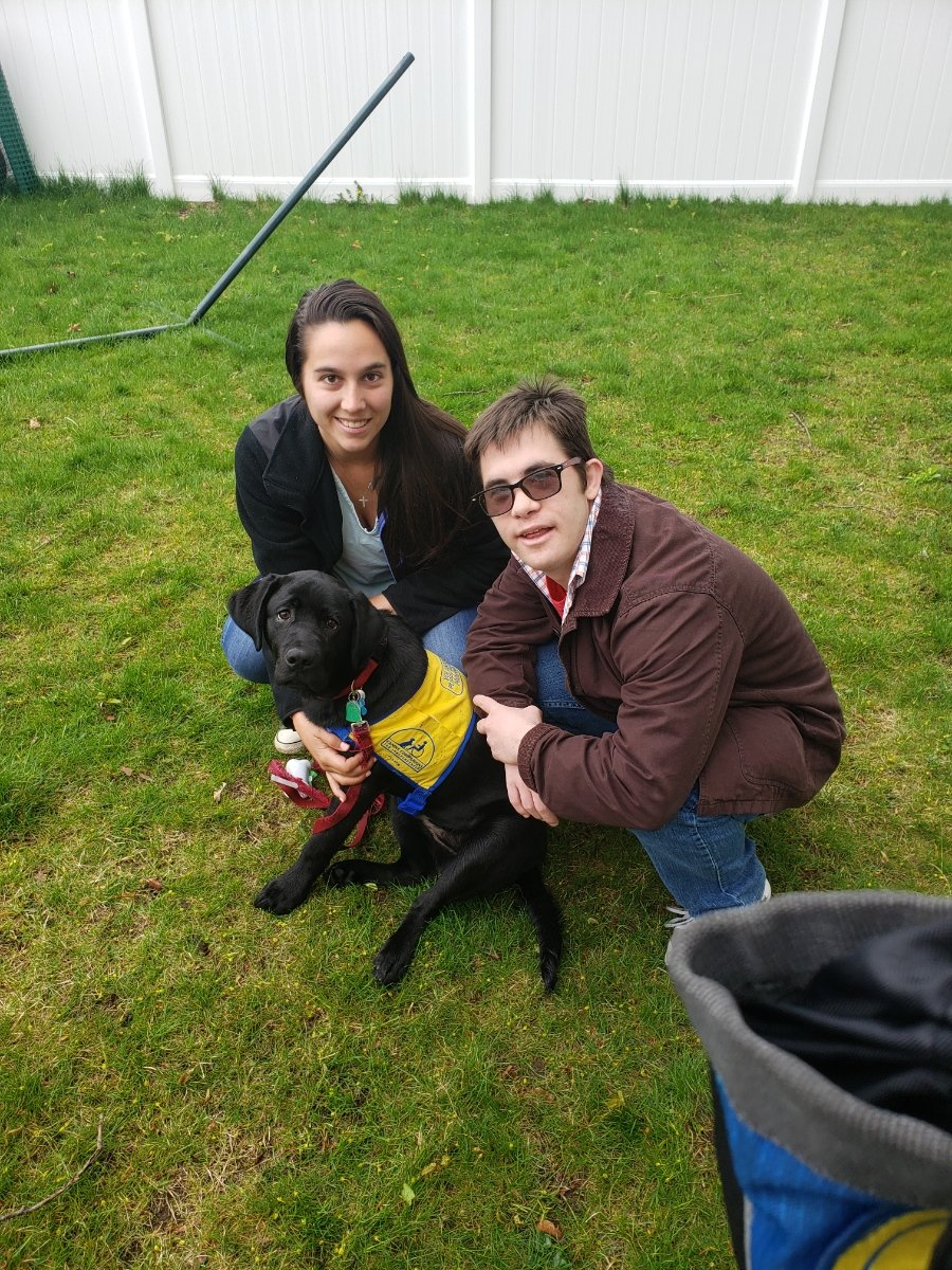 Oceanside resident Nicole Milano and PJ Marckesano, an adult with special needs that she works with at Independent Support Services, are training a black lab named Hilo together.