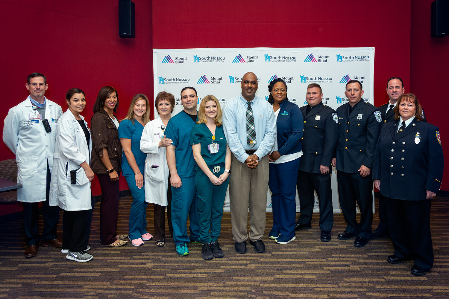 Mason, center, reunited with Allen-Ibitoye, to his immediate left, and the team of first responders from the Lynbrook Police Department, as well as the nurses and cardiac physicians who helped save his life on May 2 at a news conference at South Nassau.
