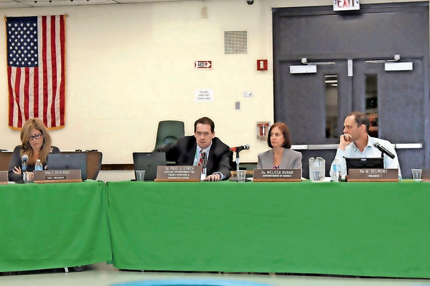 Dr. Paul Lynch, the Lynbrook School District's assistant superintendent for finance, operations and information systems, center, said that seven projects covered by a $28.9 million bond, approved by voters in 2017, were the first to be approved by the State Education Department.