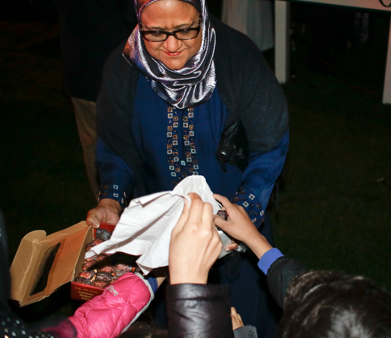Shafi Rafeek passed out dates to children at Valley Stream's first crescent star lighting on May 3, commemorating the start of Ramadan.
