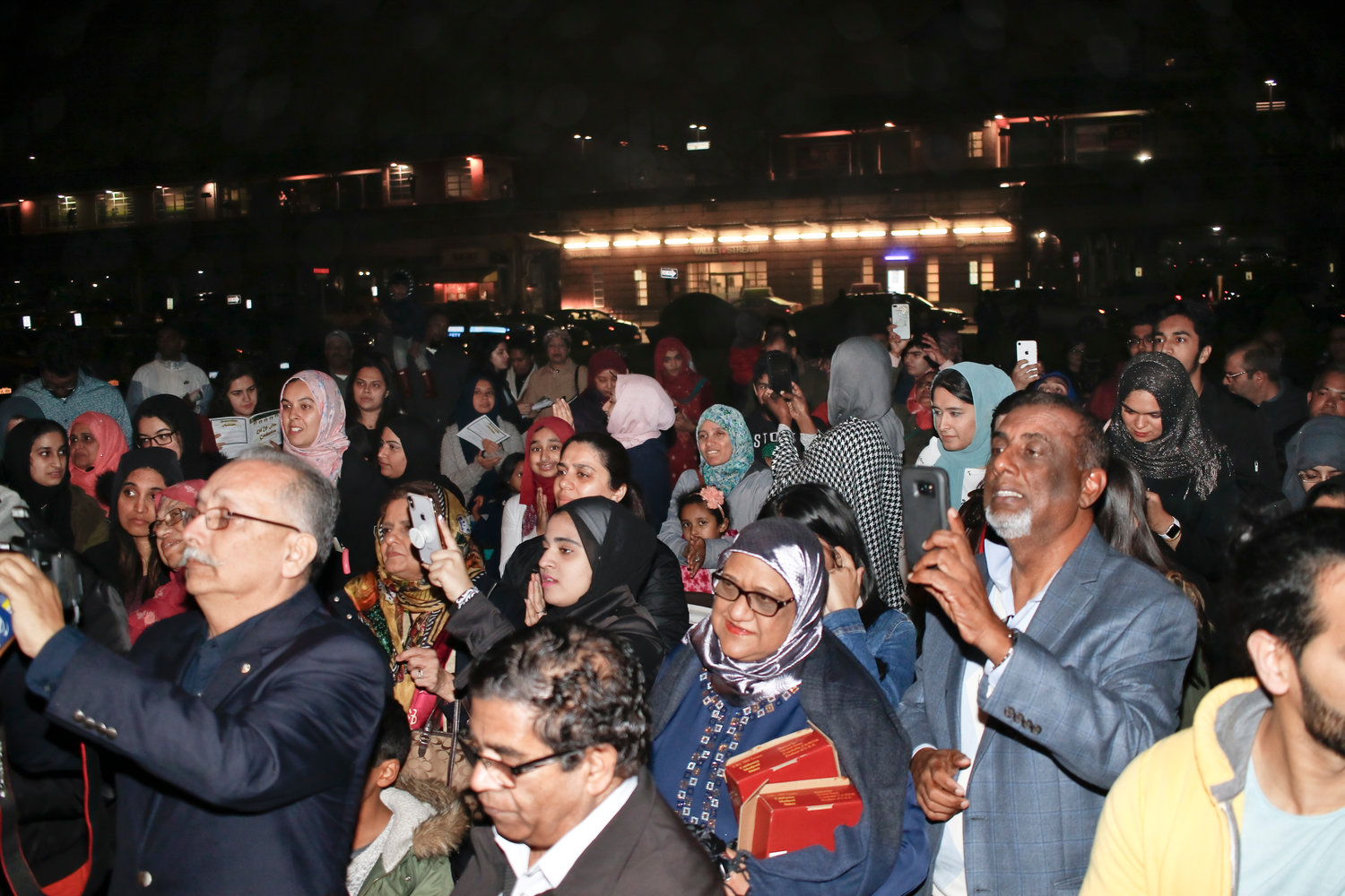 Despite chilly, wet weather, roughly 200 local Muslims attended the crescent star lighting.
