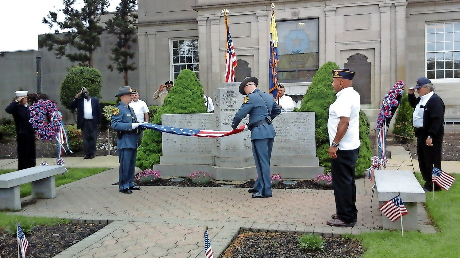 Members of the Nassau County Police Department performed the flag-folding ceremony.