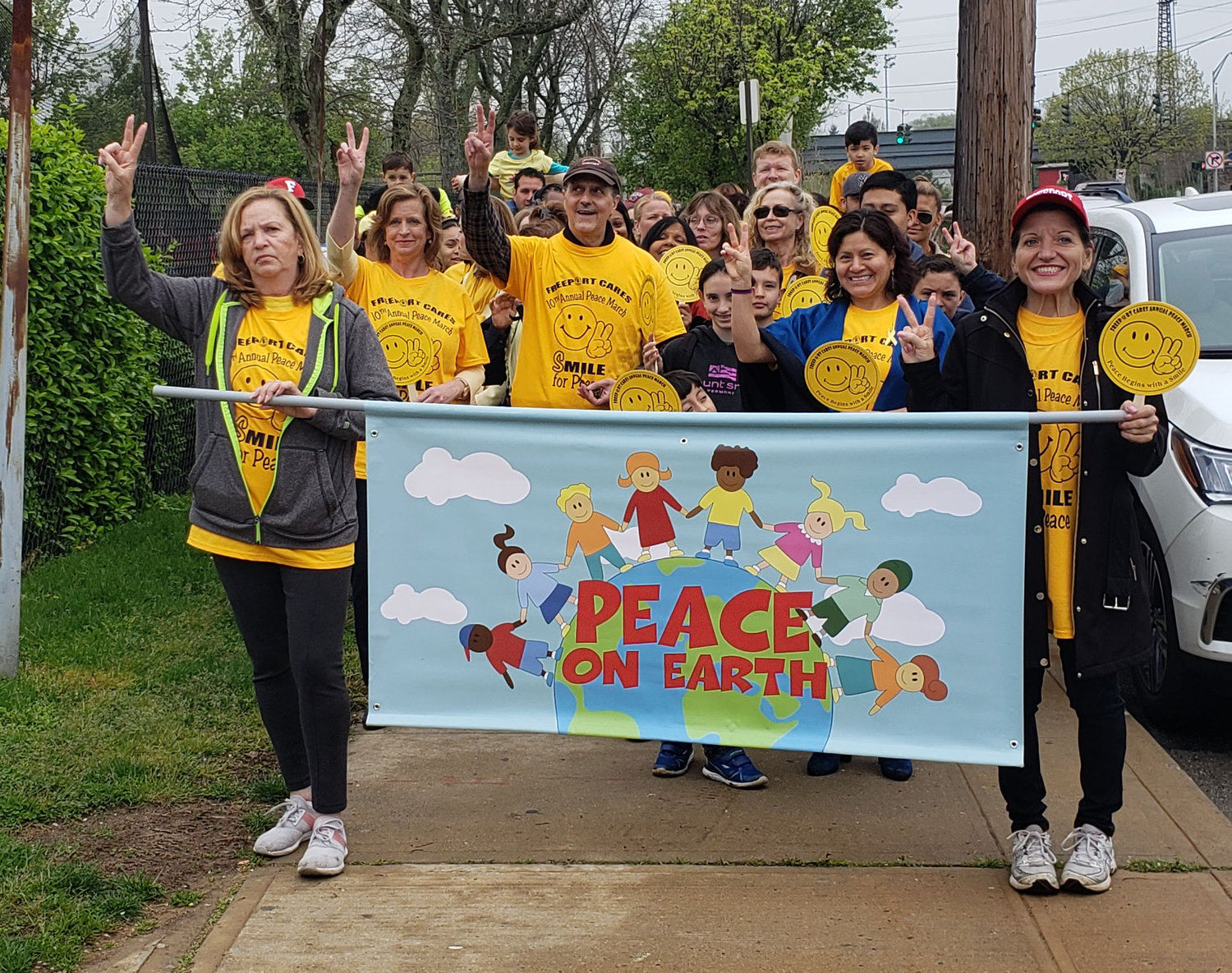 Making their way down Brookside Avenue in Freeport, marchers shared their message of peace and love.