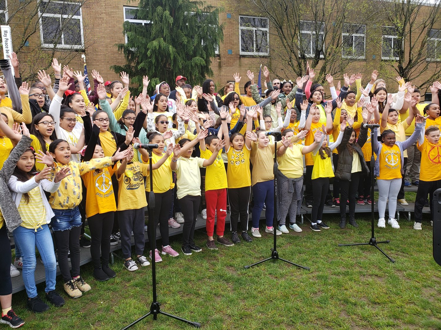 Elementary students sang songs about peace and unity in the opening ceremony.