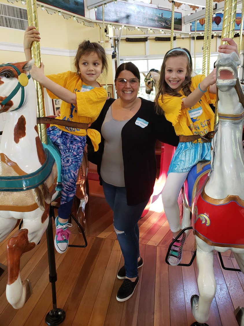 Lynbrook mother Christina Buxton, her daughter, Julianna, left, and a friend, Gianna Dambrosio, prepared to take a spin on the carousel on Tuesday.