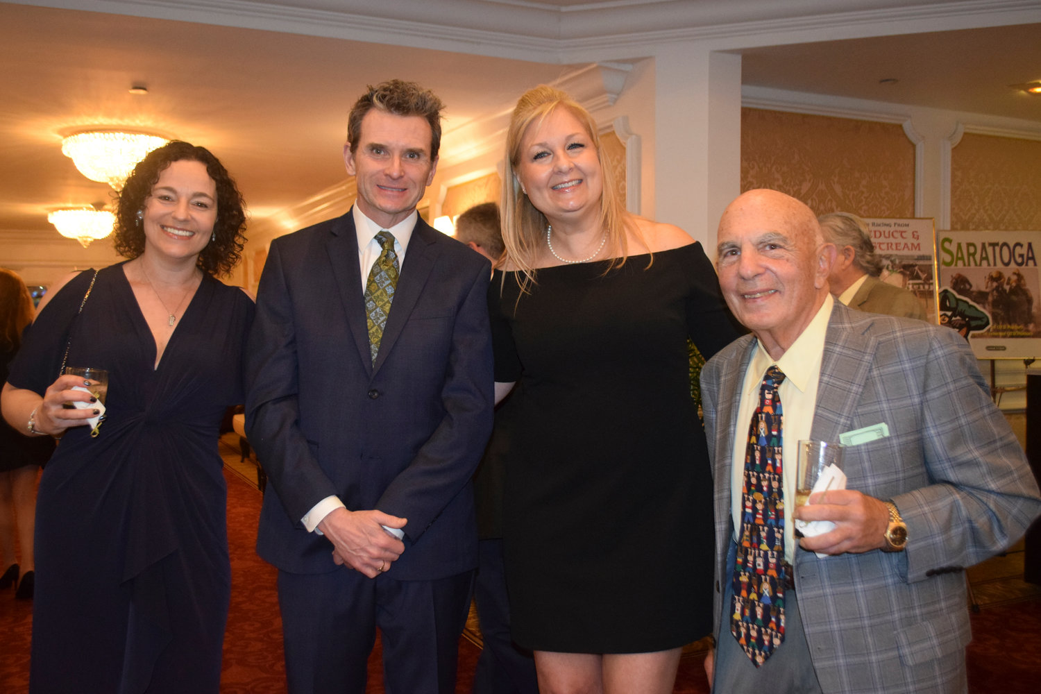 At SIBSPlace Casino Night from left were auction chair Joeanna Greenberg, Billy Bennett, SIBSPlace social work intern Susanne Bennett and SIBSplace founder  Michael Schamroth.