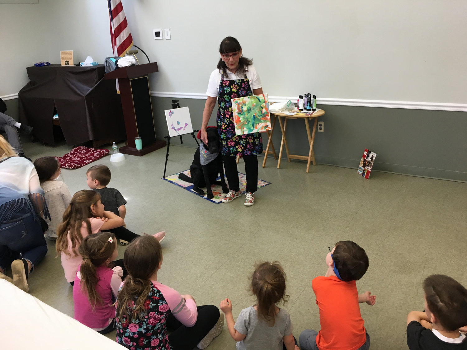 Yvonne Dagger, of Massapequa, and her 6-year-old black Labrador-golden retriever mix, Dagger DogVinci, visited the Wantagh Public Library on April 25 for an hour of painting.