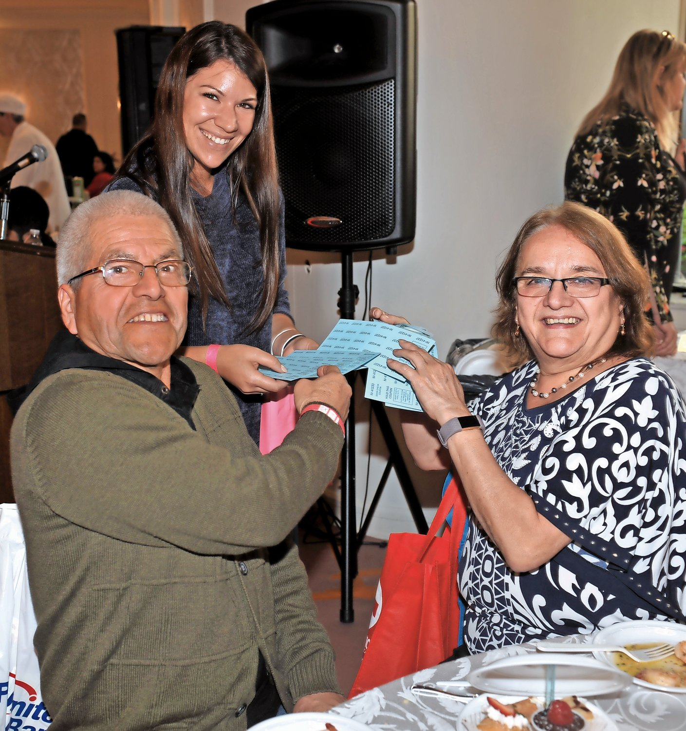 Ashley Casale sold raffle tickets to Luis and Maria Pina.