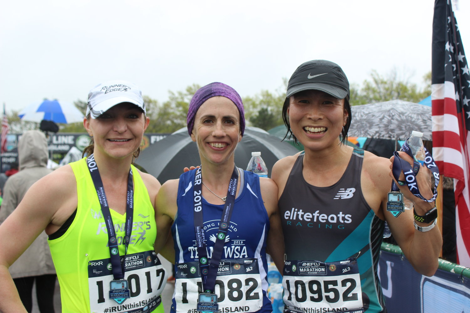 Michele Walker, left, of Massapequa, Shari Klarfeld, of Plainview, and Michiko Clarke, of Westbury, finished first, second and third among the women competing in the 10K race at the NEFCU 2019 Long Island Marathon on Sunday.