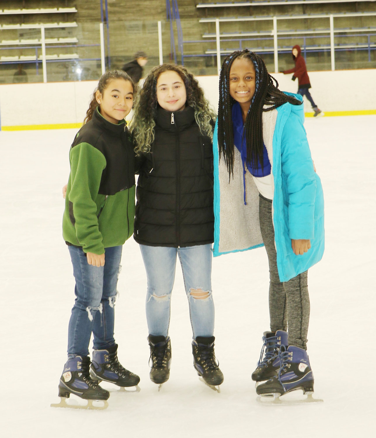 Eliana Bitten, left, Emily Mendoza and Spencea Grause skated together at Tween Nite Out.