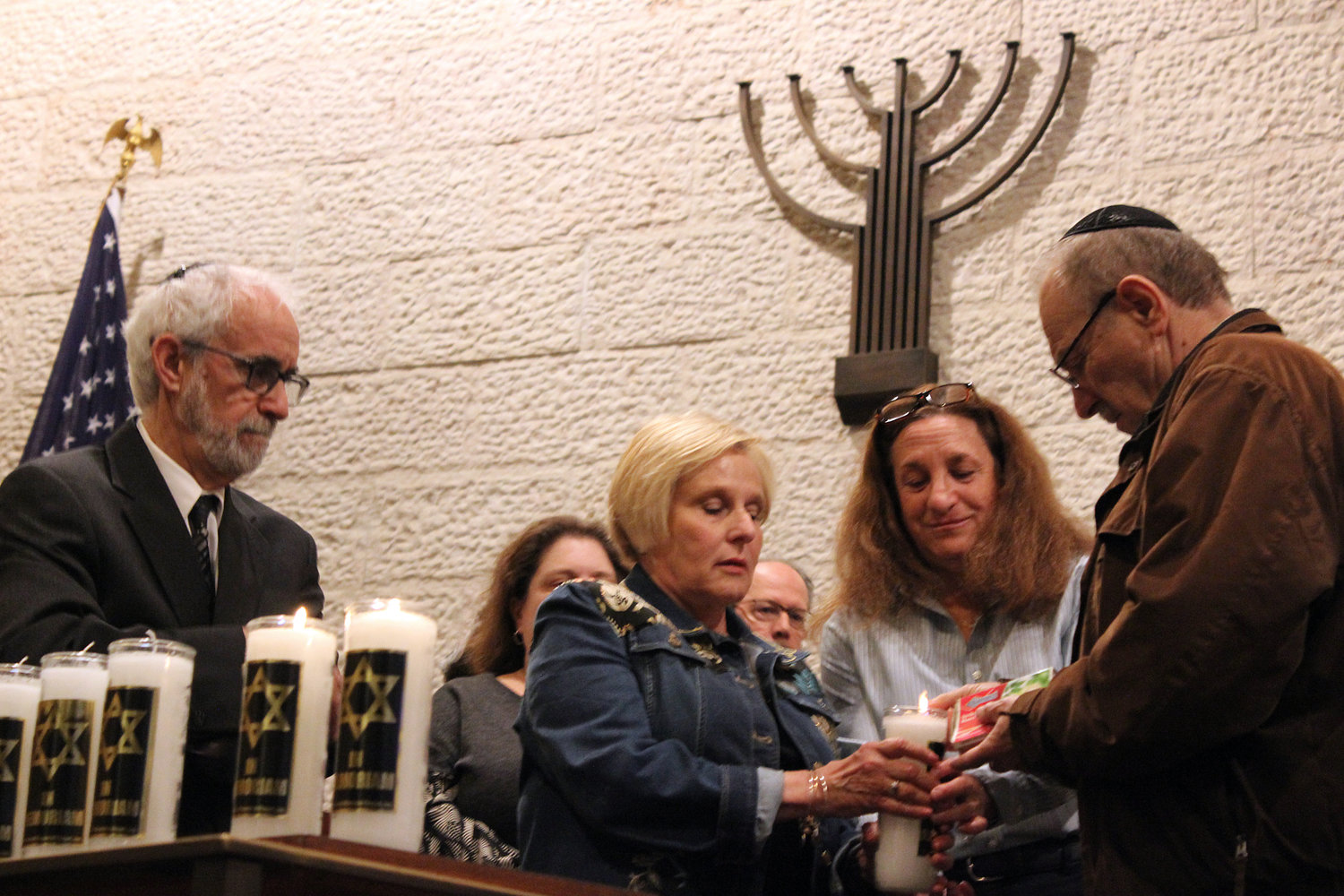 Rabbi Ronald Androphy invited Holocaust survivors and children of survivors to light a candle in remembrance at a service to commemorate Holocaust Remembrance Day at the East Meadow Jewish Center on May 2.