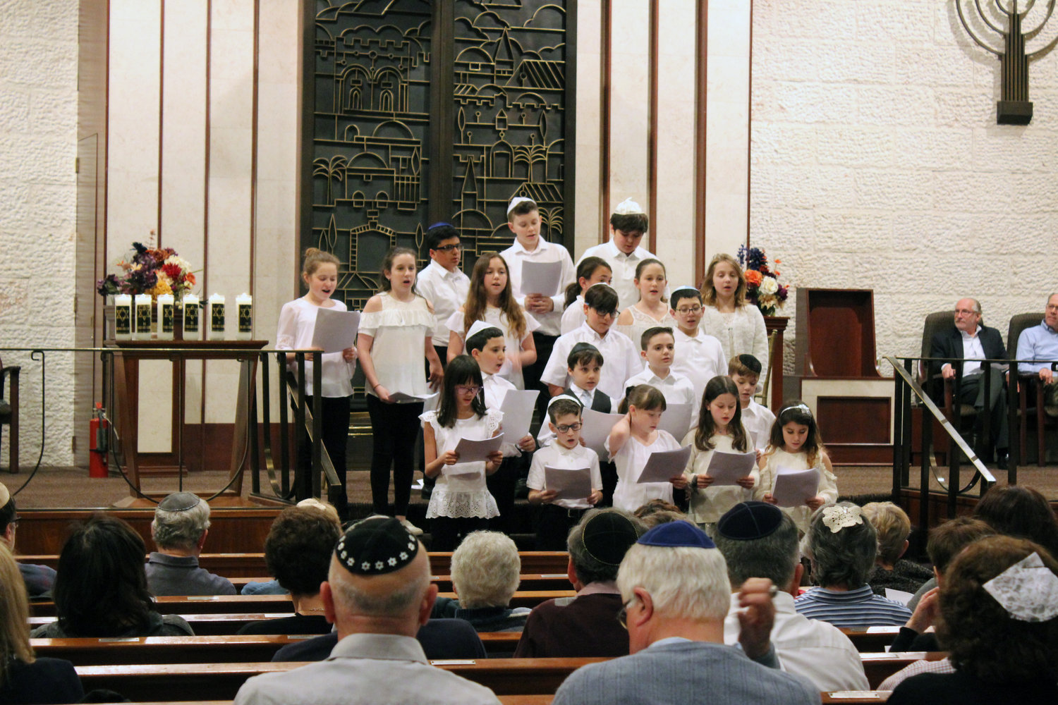 "Children sang songs for the congregation, such as Matisyahu's ""One Day."""
