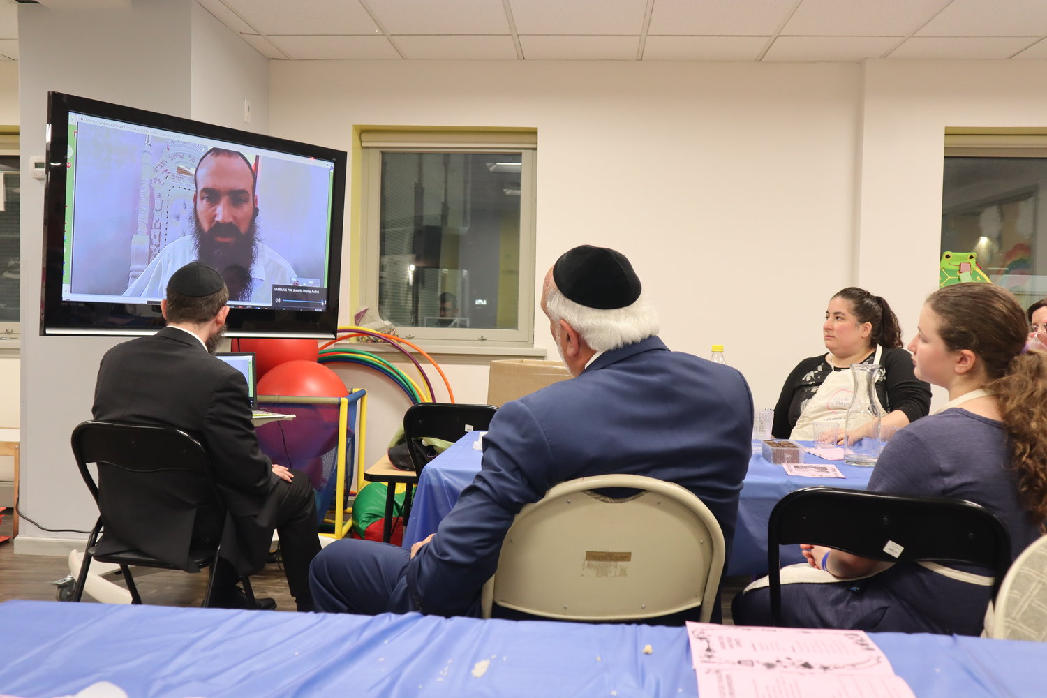Assistant Rabbi Mendy Rubenfeld, from the Poway Chabad, called in to speak with members of the Chabad Center for Jewish Life, offering a message of hope. He showed congregants the hundreds of flowers left outside and notes of love posted all over the walls.