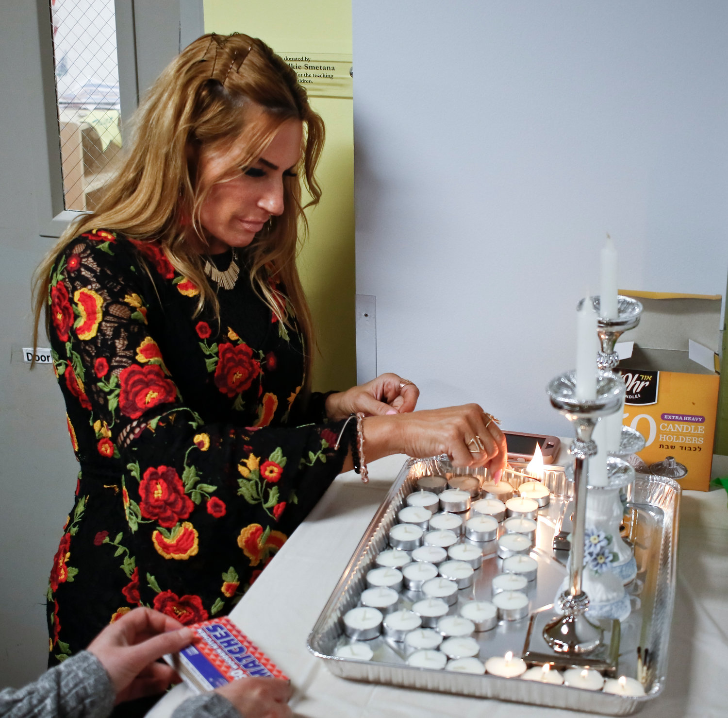Stacy Feldbrandt lit a candle at the Friday night Shabbat candle-lighting ceremony.