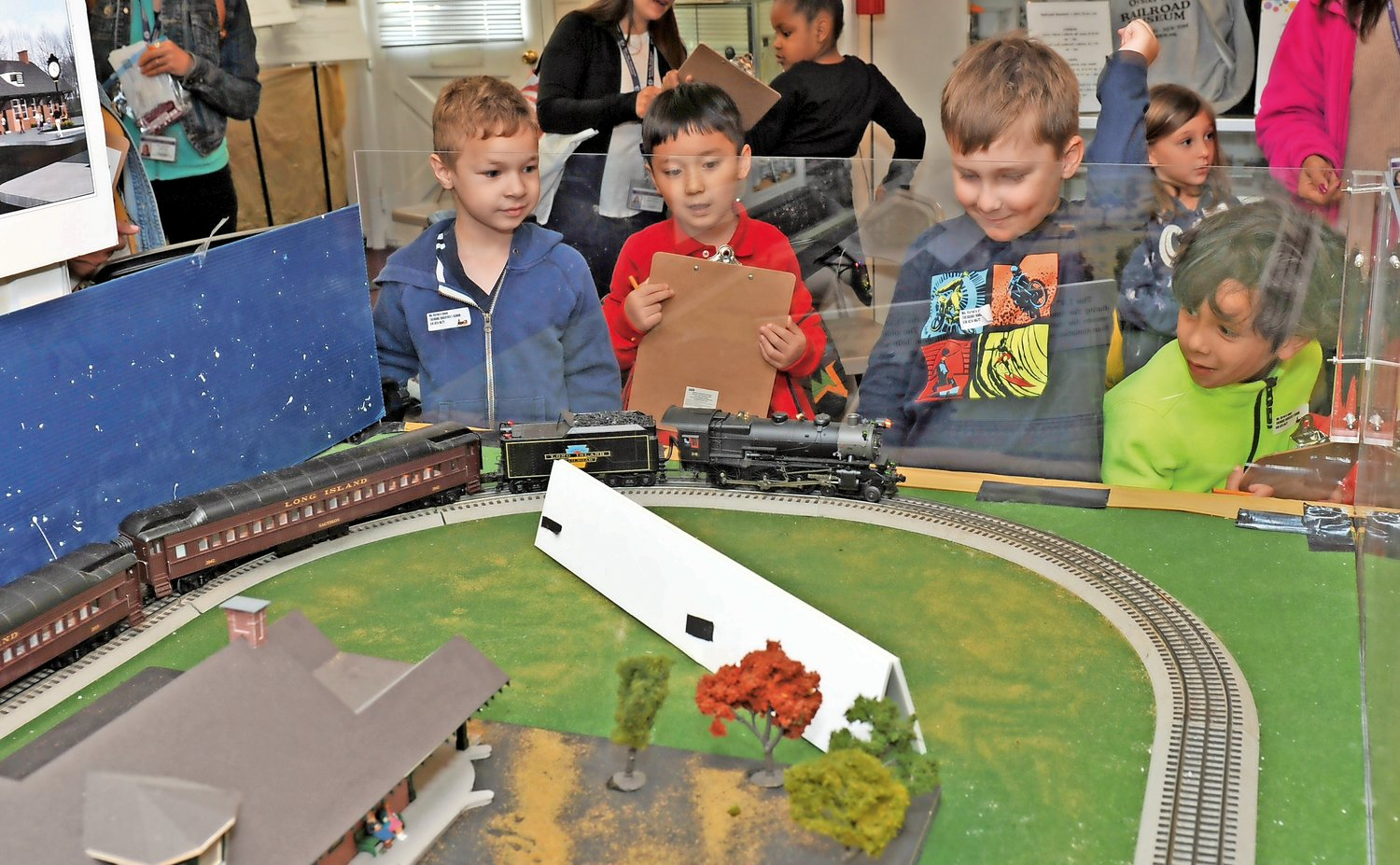 Richard Bebenec, far left, Austin Zhang, Trevor Malone and Johan Flores watched a model train at the Railroad Museum's visitor center.