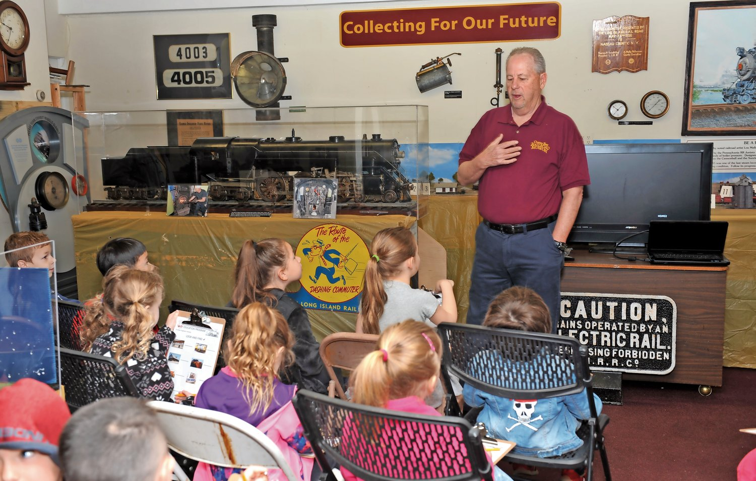 Bill Burke, the volunteer in charge of education programs at the museum, shared the history of the Oyster Bay railroad station with the kindergartners.