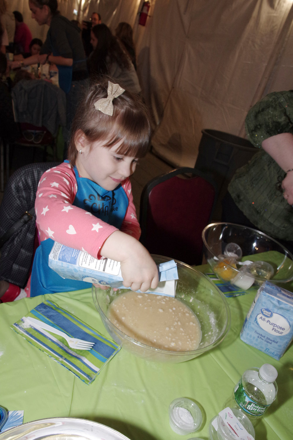 Sofia Gavrylyuk, 4, showed her pouring skills at the challah bake.
