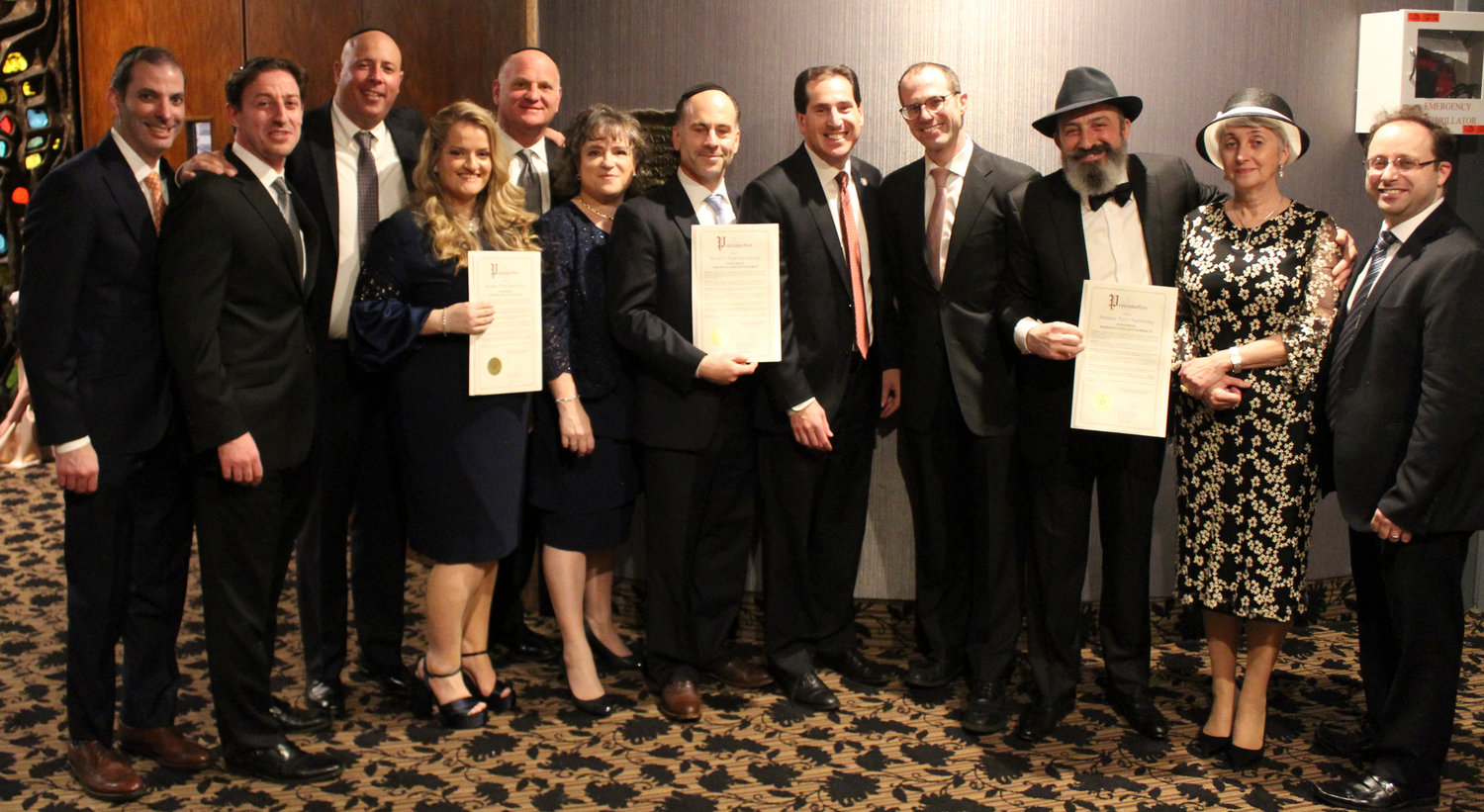 The Sephardic Temple hosted Young Israel of North Woodmere's annual dinner. From left were Jack Aspir, Alex Marcus, Zvi and Judith Gutman, Glen Skolnick, Michele and Eli Chaikin, State Sen. Todd Kaminsky, Rabbi Yehuda Septimus, Zev and Mariana Gorbach, and Yitzie Horowitz.