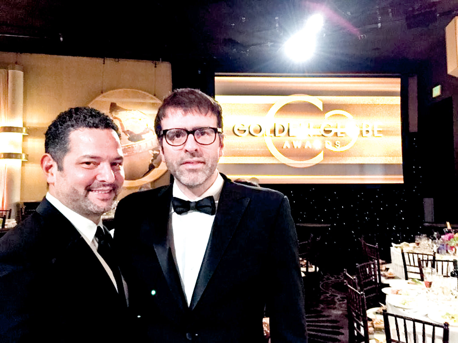 Dinelaris, near right, attended the 2015 Golden Globe Awards with his writing partner, Nicholas Giacobone.