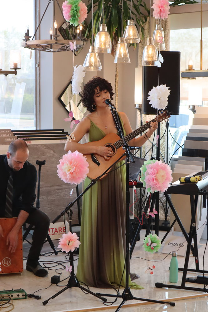Bianca Muñiz, a two-time cancer survivor by age 22, expresses her struggle through music. At the fundraiser, she performed her songs, some of which spread messages of hope to her fellow Breasties.