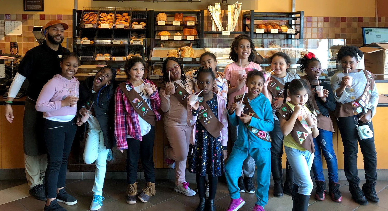 Taliyah Baptiste, third from left, on a 2018 trip to Panera Bread in Rockville Centre with Girl Scout Troop 2453.