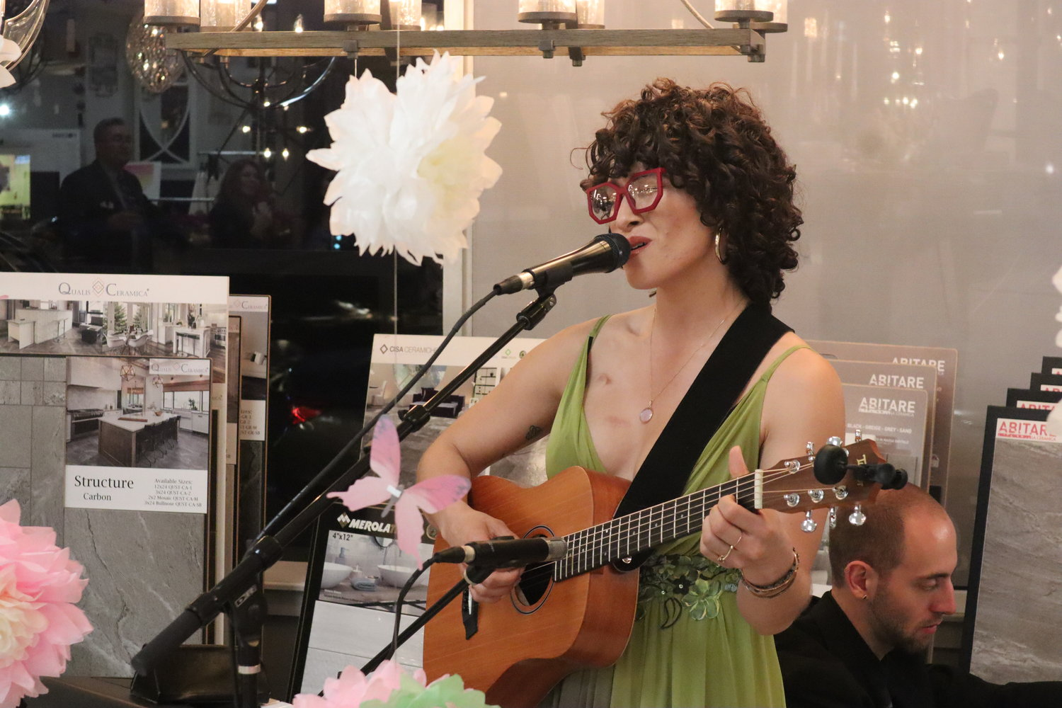 Bianca Muñiz performed original songs of hope and love at a fundraiser to support women under 40 with breast cancer. Patricia Salcedo, a survivor of another sort, hosted the event at III View Designs and Construction, which she started when her former business was ravaged during Hurricane Sandy.