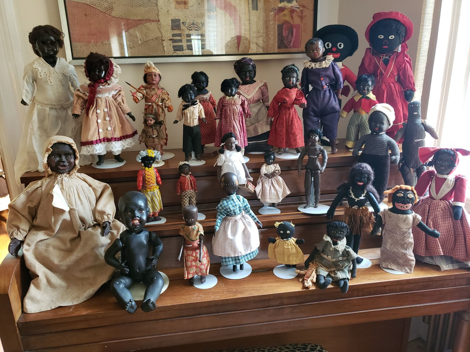 Freeporter April Marius has collected 362 rare and antique dolls of color, which she carefully stores at her home.