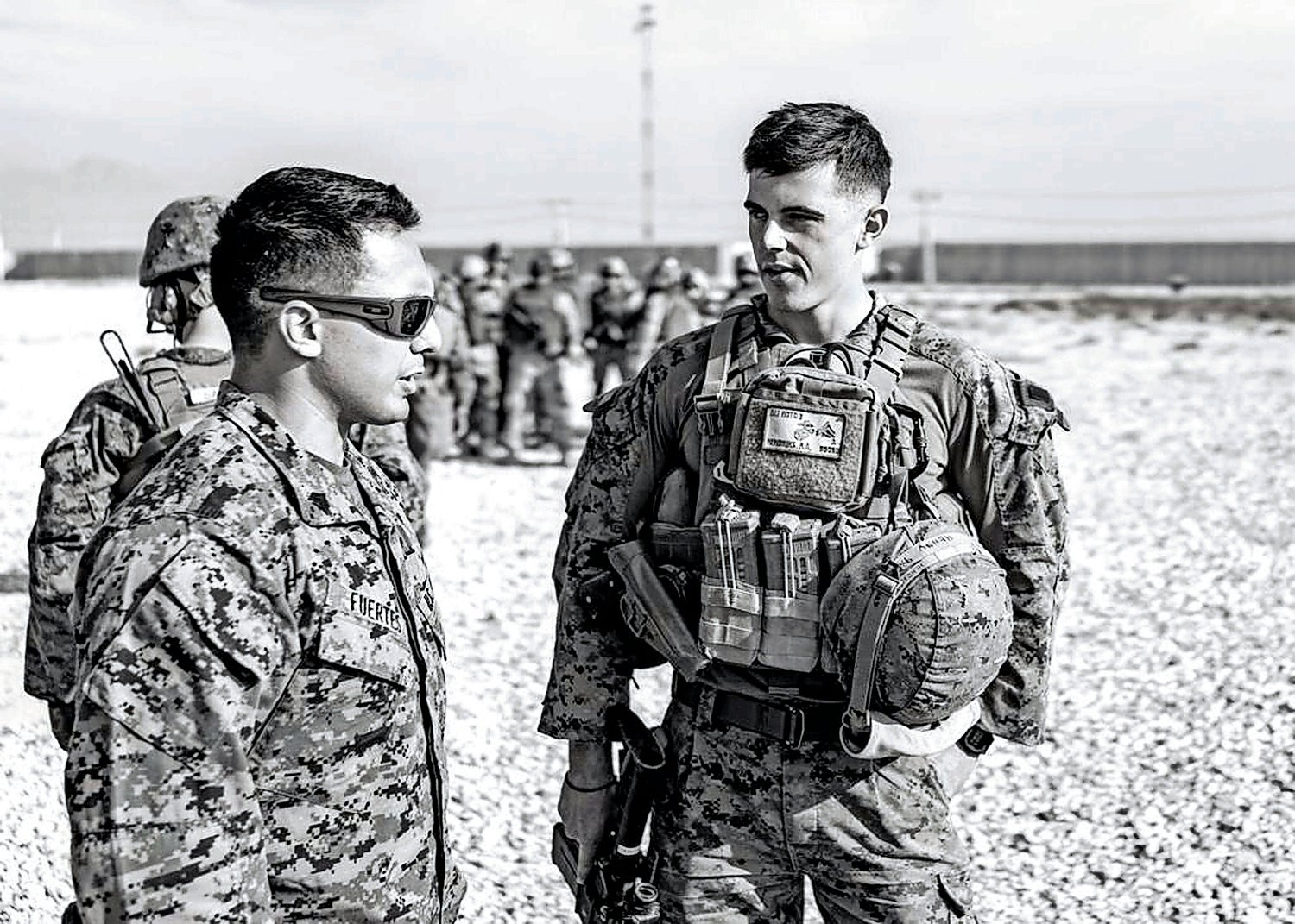 Hendriks, right, with his commanding officer and good friend Staff Sgt. David Fuertes.