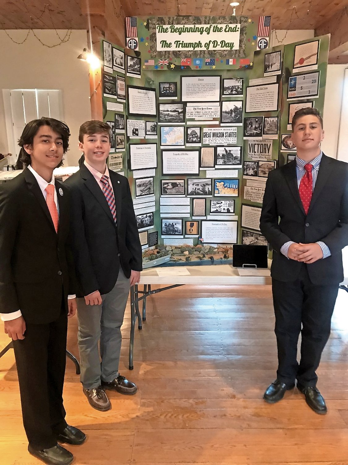 Christian Holden, left, Nicholas La Rosa and Michael Granelli with their History Day project.