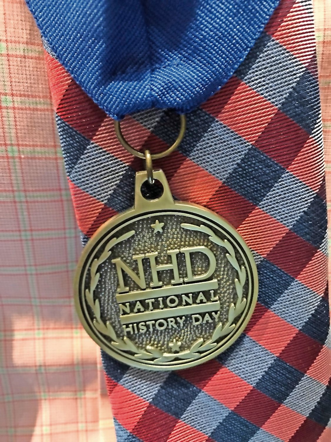 Nicholas wore his first place History Day medal with pride.