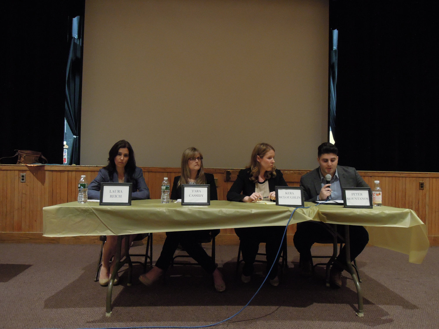 Wantagh Board of Education candidates, from left, challengers Laura Reich and Tara Cassidy, Trustee Kera McLoughlin and board President Peter Mountanos shared their views on the role of a trustee at an event hosted by the district's PTAs at Wantagh High School on May 7.