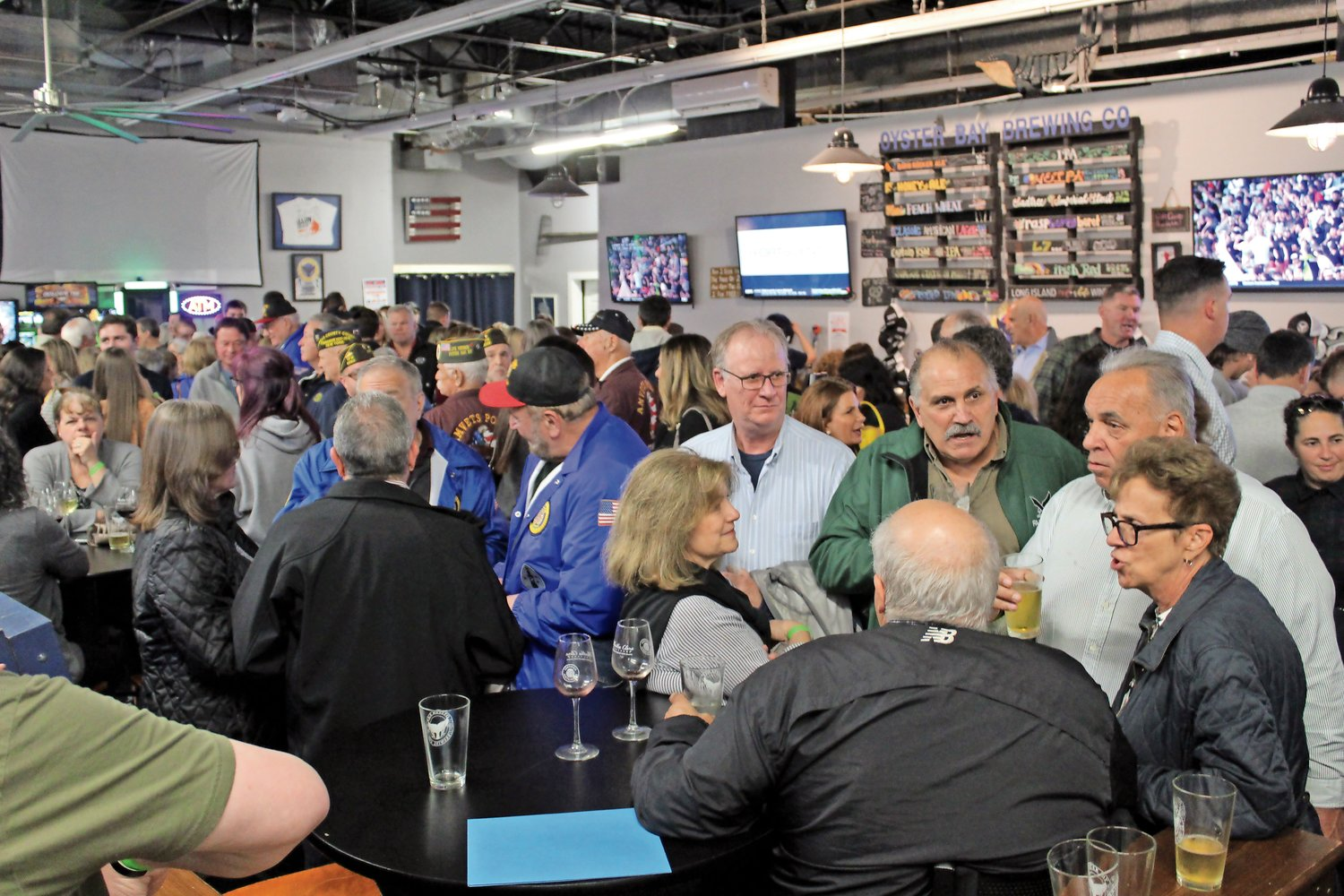 The Oyster Bay Brewing Company was packed to capacity with residents from every sect of community life.