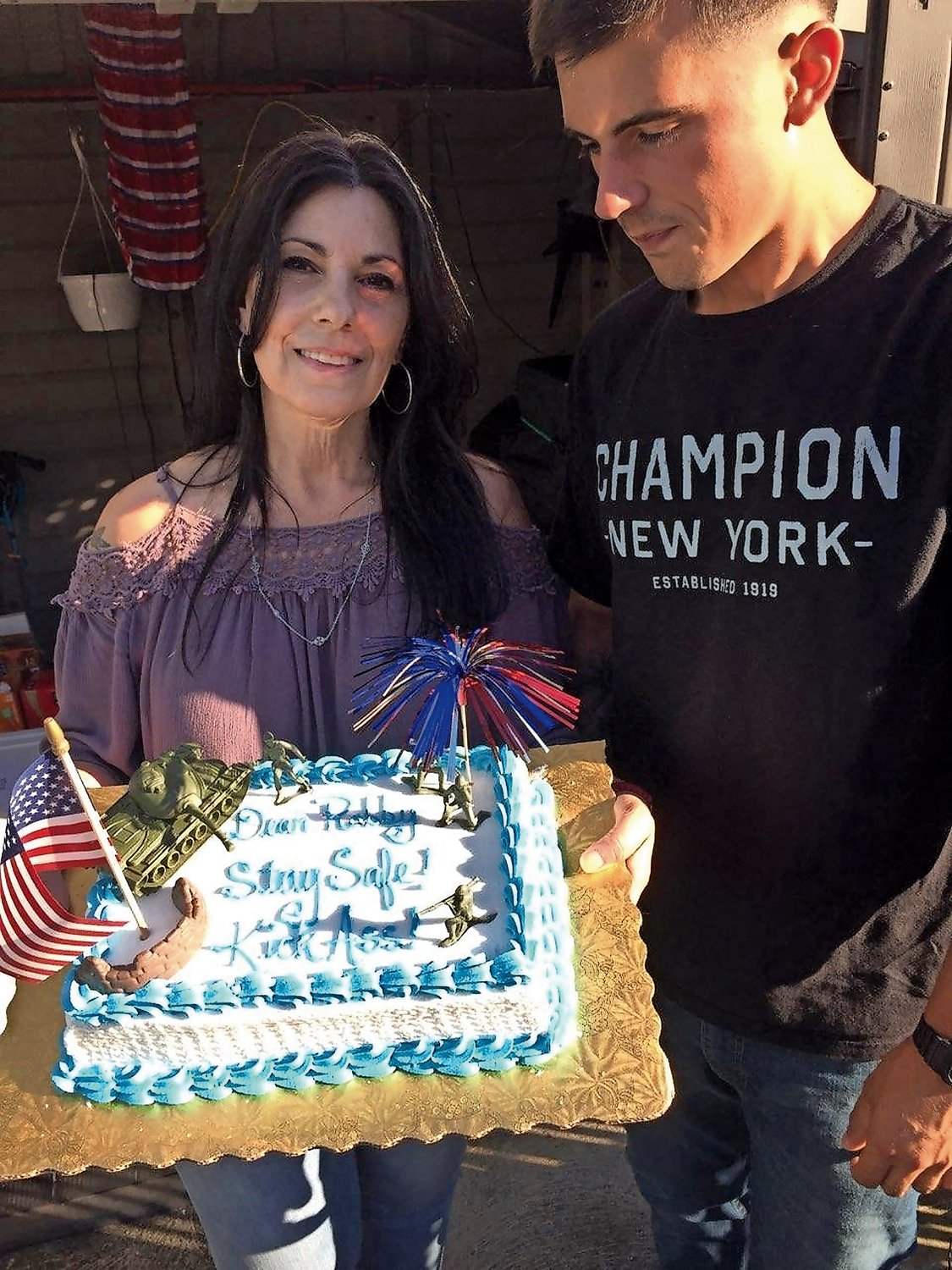 "Felicia Arculeo and her son, Robert Hendriks, before he left for Afghanistan, at what she said was his ""see you later party."""