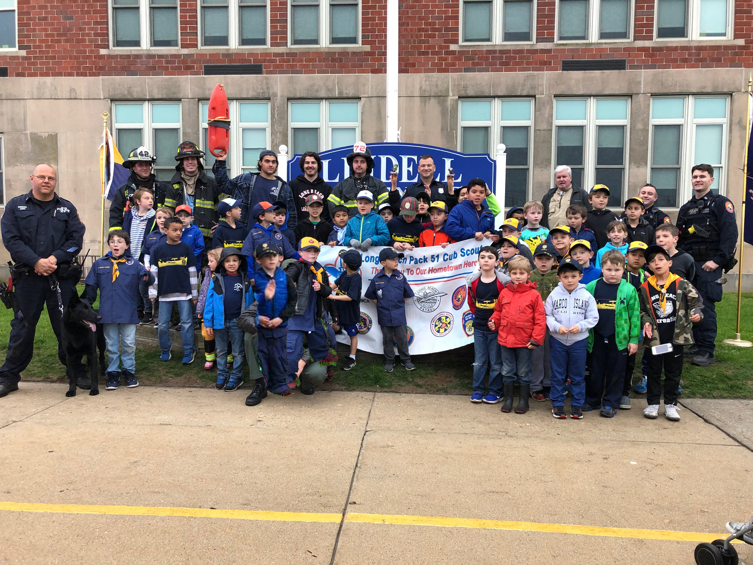 "Members of local law enforcement spoke to Cub Scout Pack 51 at a ""Hometown Heroes Pack Meeting"" on May 3."