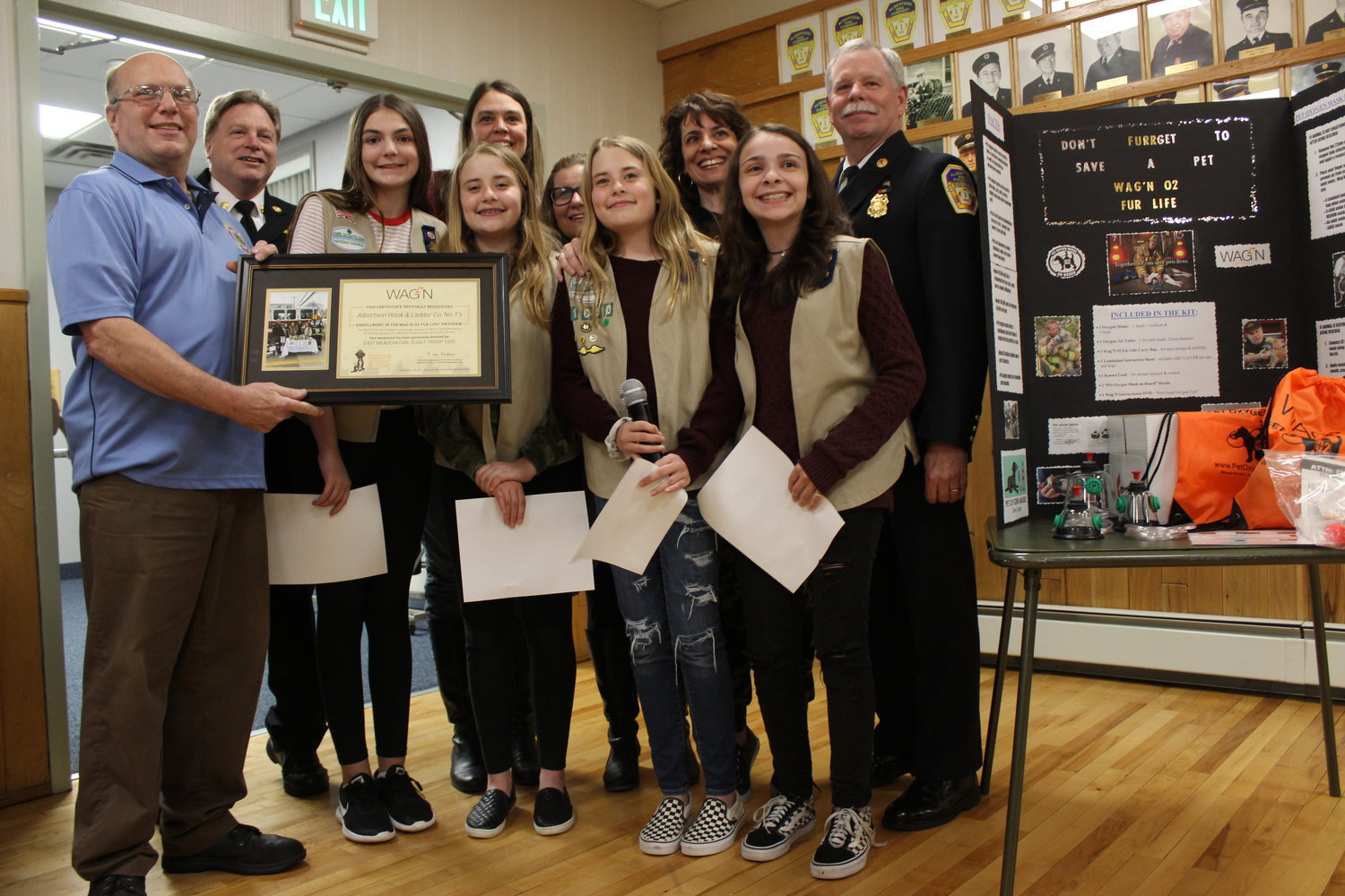 Chiefs Jay Janowitz, left, Joe Melamed and Timothy Farrell, far right, with Megan, Emily, Kate, Corrine and their parents, Maureen Hand, Patty Leahy and Pamela Rufolo.