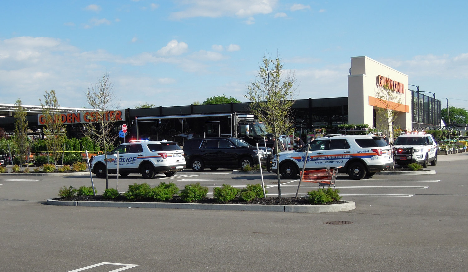 Police vehicles surrounded the Home Depot store and garden center on Hempstead Turnpike in Levittown on Wednesday as a suspicious package was investigated by the NCPD bomb squad.
