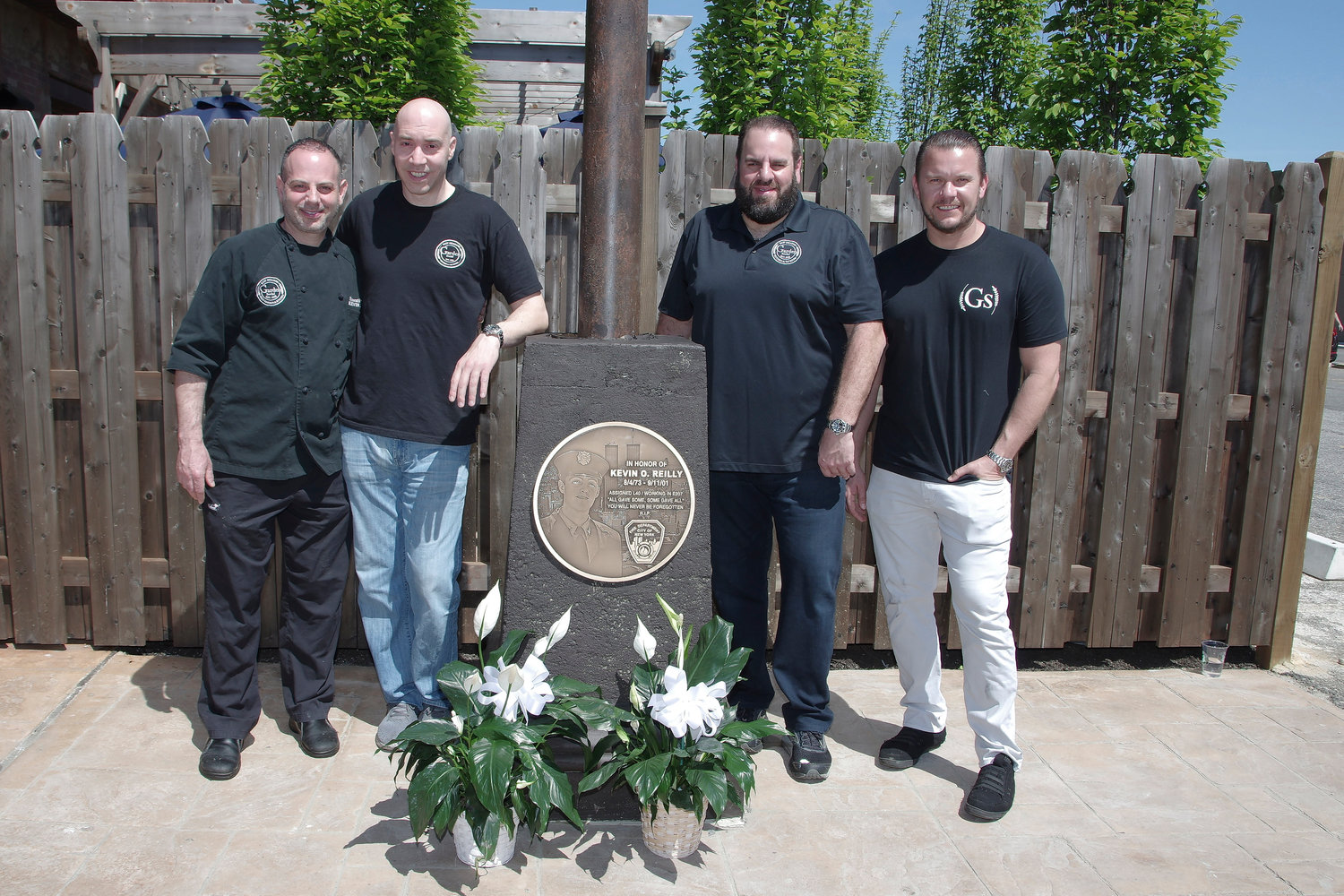 Kevin Liebov, James Paloumbis, Bob Russo and Dave Boller, all partners of Garden Social in East Meadow, dedicated a plaque to their close friend Kevin O'Reilly, who died responding to the September 11, 2001 terrorist attacks in Manhattan.