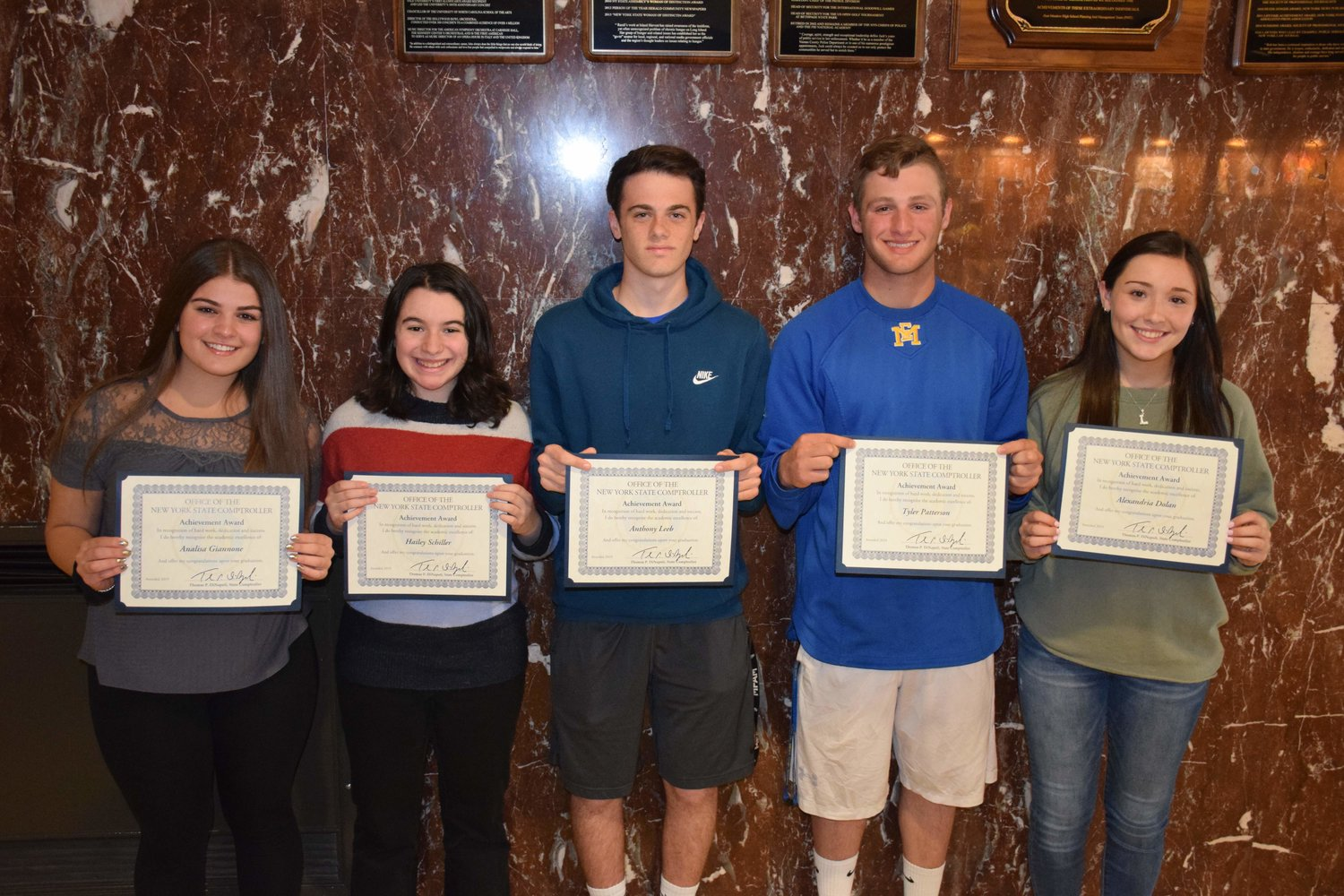 East Meadow High School seniors Analisa Giannone, left, Hailey Schiller, Anthony Leeb, Tyler Patterson and Alexandria Dolan were honored with the 2019 New York State Comptroller's Student Achievement Award.