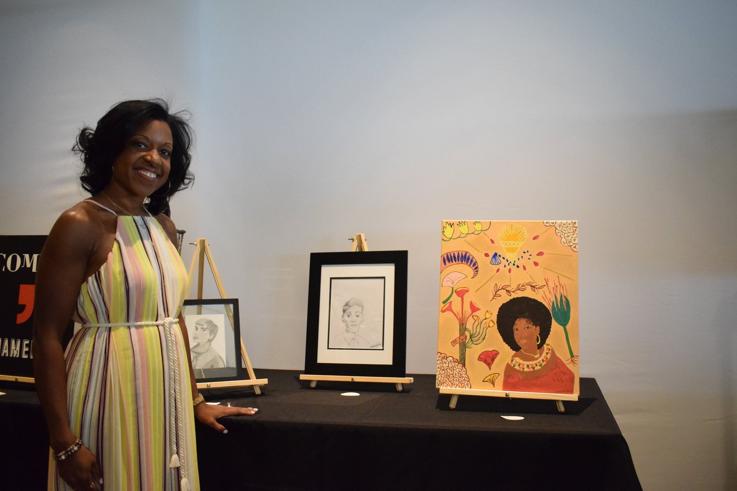 Natasha Welch, of the Elmont Muscle Moms, helped set up the Elmont Art Gallery and displayed her own original artwork.