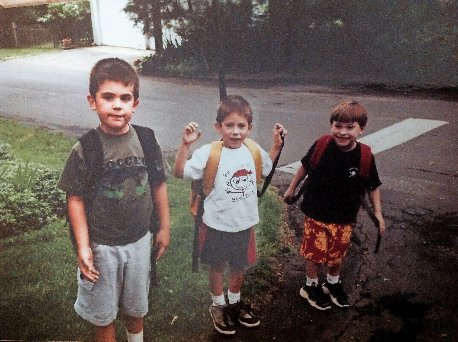 Then-first-grader Robert, left, at the bus stop.