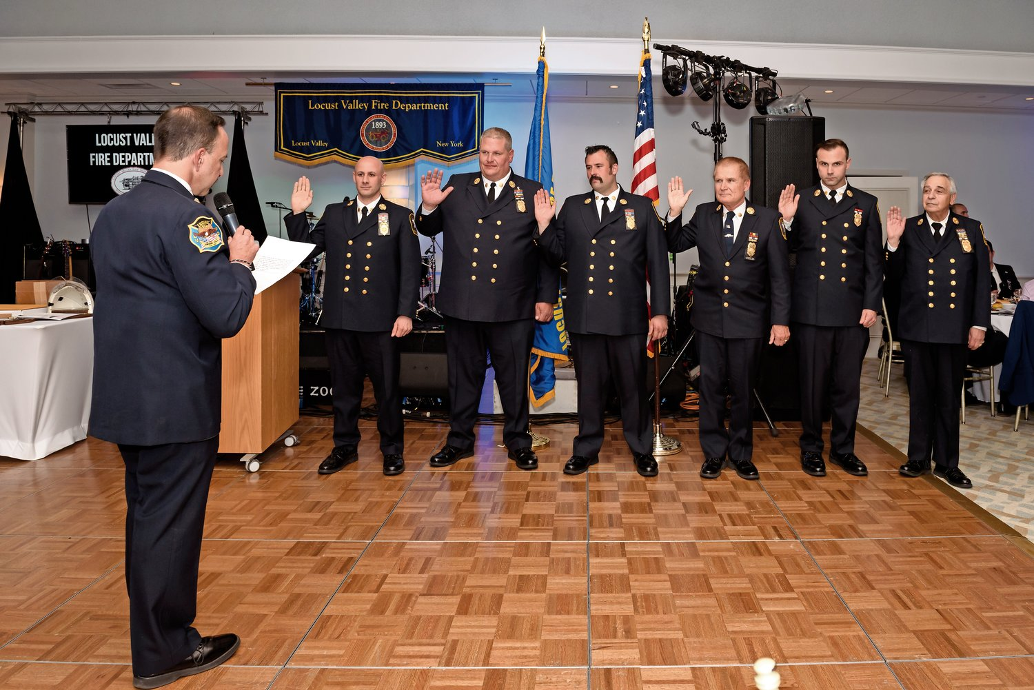 Ex-chief Jeffery Baker, left, installed the new chief, Andrew Akapnitis, and department officers James Neumeyer, Ralph Longo, Jeffrey Converse, Matthew Stimola and Michael Bono.